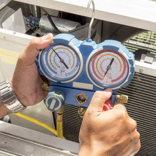 Technician Measuring Power for Air Conditioner
