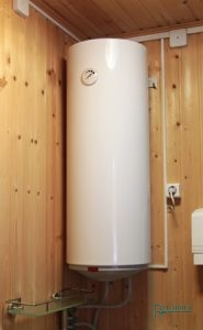 An Electric Water Heater Hanging On a Wooden Wall