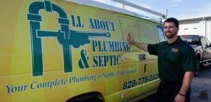 Plumber Leaning Against Van