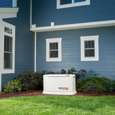 A Generac Generator in Front of a Home.