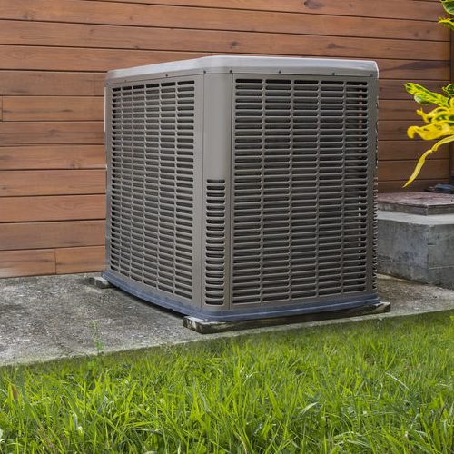 A Picture of a Heat Pump On the Side of a House.