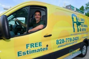A Picture of a Man Sitting in an All About Plumbing & Septic Truck