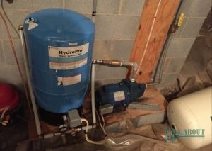 A Picture of a Well Water Tank and Pump